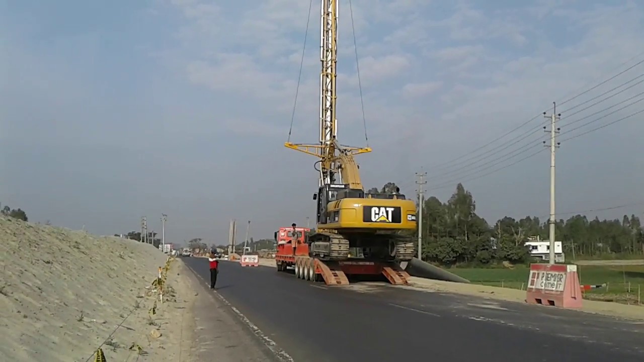 Amazing Video ! CAT PVD Excavator Loading in Truck Dhaka-Khulna 4 lane road  improvement project