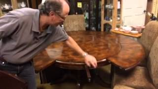 Expendable mahogany round six leaf perimeter dining room table
