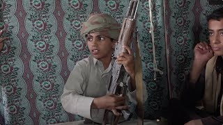 Boys fight alongside men in Yemen war