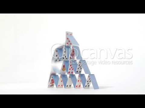 Stock Video House Of Stacked Playing Cards Falling Down Eventually