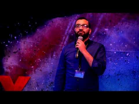 Traveling as a Volunteer - السفر كمتطوع   Mahmoud Abd ElMageed   TEDxWadiElrayan