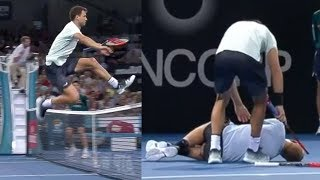 Grigor Dimitrov JUMPS the Net to Help After Opponent Goes Down with Injury