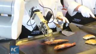 Chinese robot cooks, serves food at restaurant