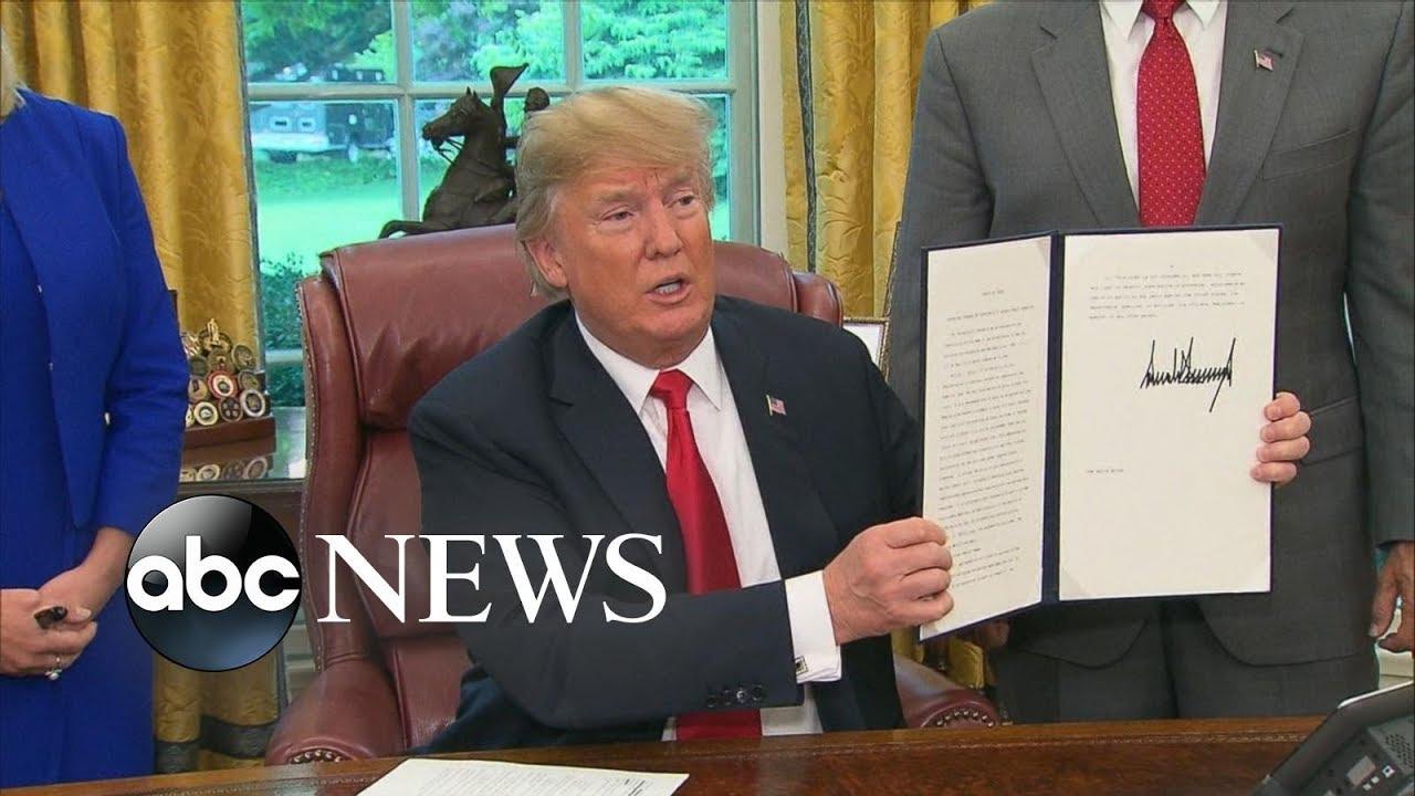 Trump signs executive order ending family separation policy at US-Mexico border