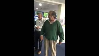 Asian man gets angry at a betting shop