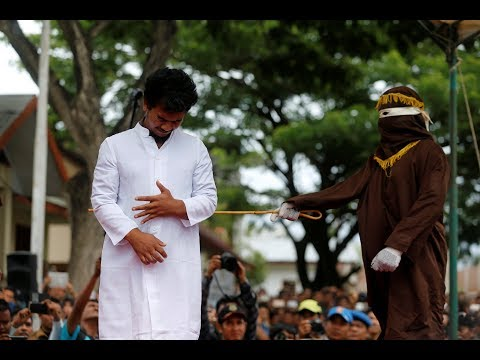 Two men publicly caned in Indonesia for having gay sex