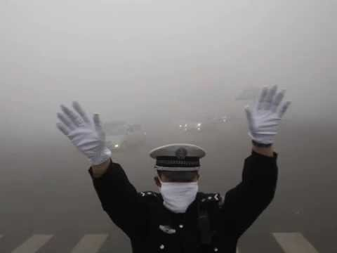 heavy smog in the Chinese city, Shenyang, caused by stone coal plants .