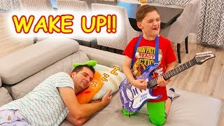 Children try to Wake Sleeping Father with Pretend Play Music Toys!