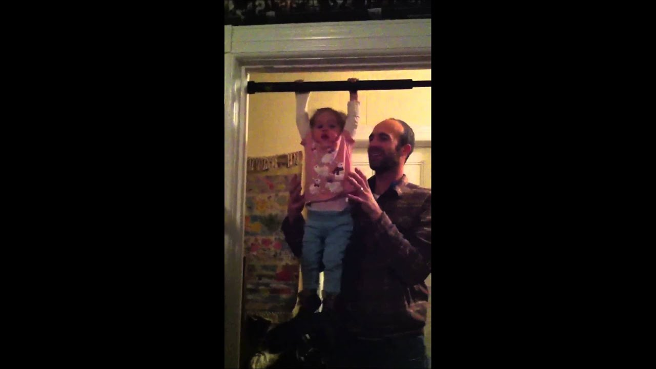 Baby Hanging From A Pull Up Bar