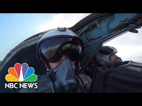 Russian Warplanes Carry Out Bombing Drills In Baltic Sea | NBC News