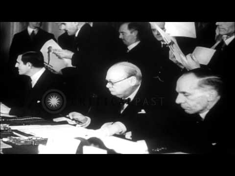 Prime Minister Winston Churchill and United States Ambassador Winant sign the Epo...HD Stock Footage