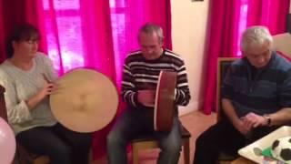 Family playing traditional Irish music on the bodhran