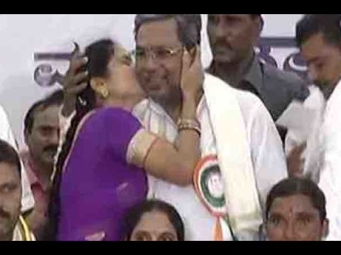 Woman kisses Karnataka CM Siddaramaiah at a public event