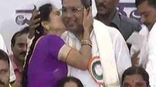 Woman kisses Karnataka CM Siddaramaiah at a public event
