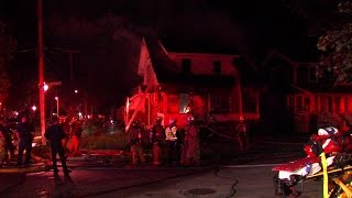 Akron firefighters fall through floor