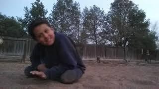 Angelo playing football with Ryan