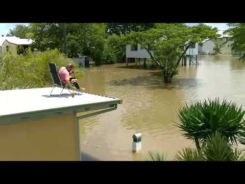 Ingham Man Drinks a Beer While Fishing From His Roof in Floodwaters