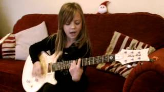 9 year old Zoe Thomson sings and plays on guitar The Pretender by Foo Fighters