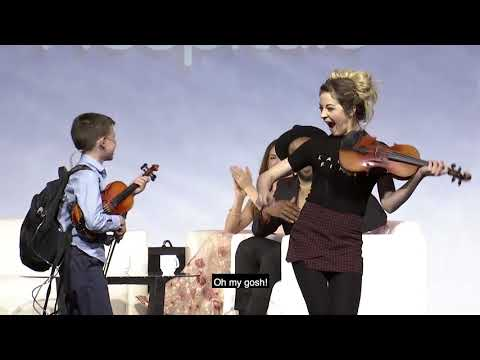 Violinist Lindsey Stirling and Miracle Kid Nate Play Together