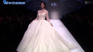 Model in wedding dress falls down during Shanghai Fashion Week 2015