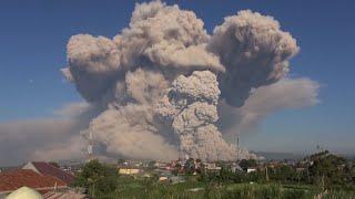 Mount Sinabung volcano in Indonesia erupts, sending hot ash into sky