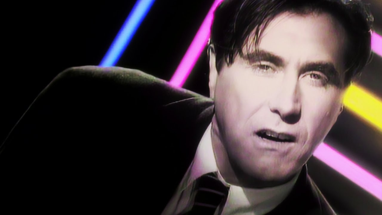 Download Bryan Ferry - Kiss and Tell (Official Music Video) Remastered @Videos80s