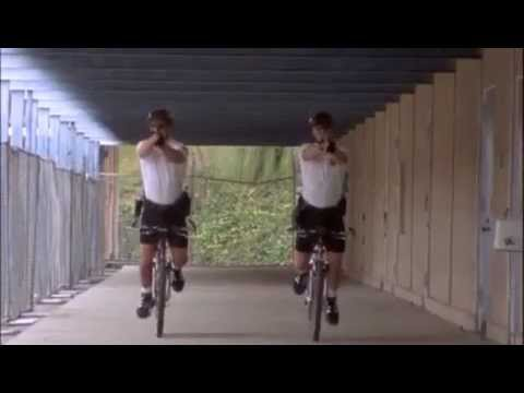 Pacific Blue: Shooting a gun with both hands while on the bike! Great move!