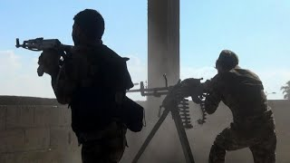 Kurdish fighters face off with Turkish forces in northern Syria