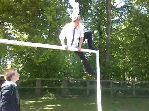 John standing on the cross bar