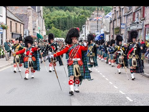 Massed Pipes & Drums parade through Deeside town to start the Ballater Highland Games 2018