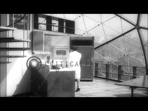 Architect Bernard Judge washes his geodesic dome 'bubble house' erected on Hollyw...HD Stock Footage