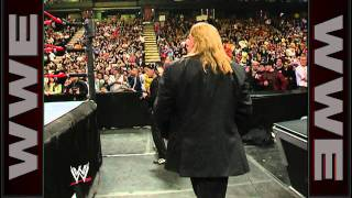 Big Show punches through Triple H's chair and a monitor