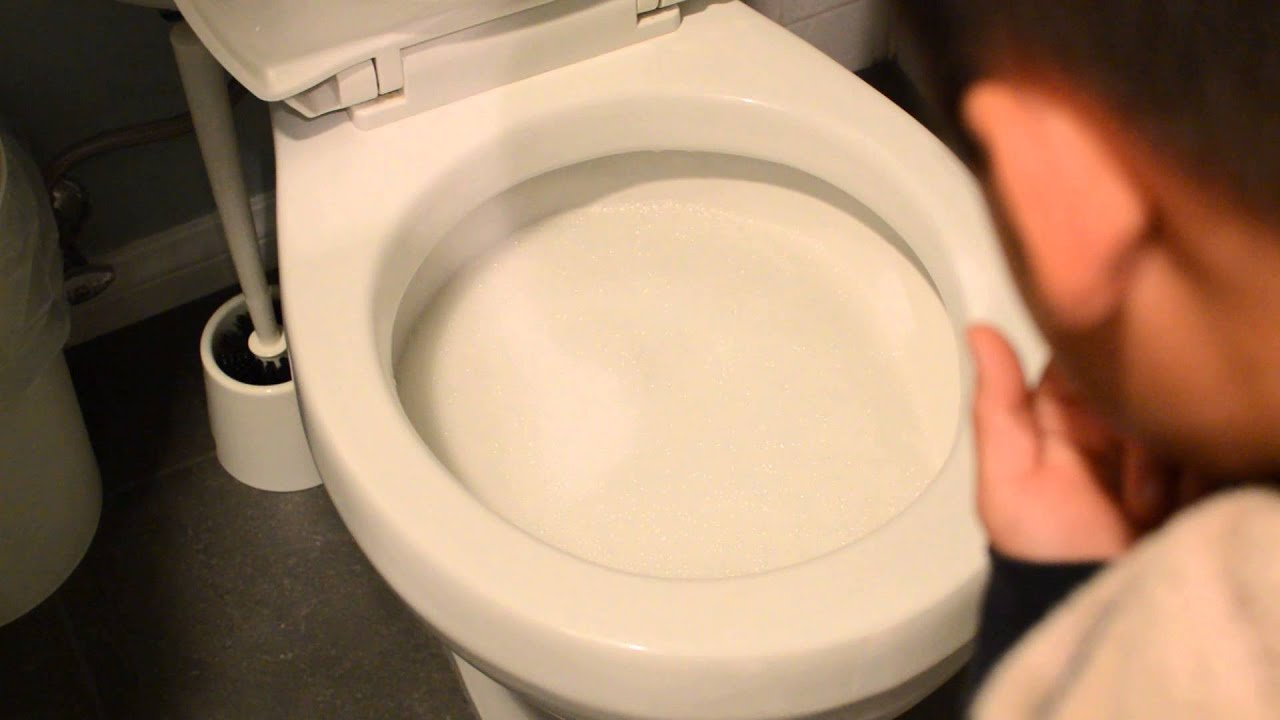 Unclogging Toilet with Baking Soda and Vinegar - YouTube
