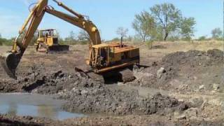 CAT 235 Excavator Digging