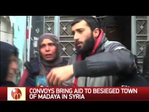 Convoys bring aid to besieged town of Madaya in Syria