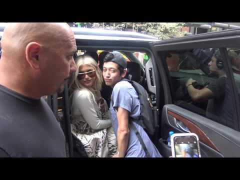 Kylie jenner poses for fans while leaving her airbnb in nyc 09-07-16