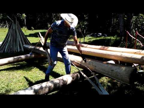 Peeling a log with hudson bay axe.