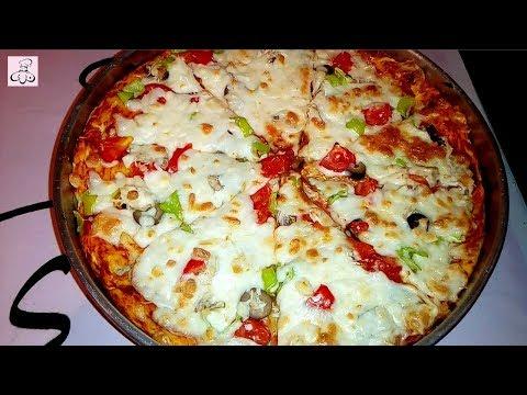 صورة  طريقة عمل البيتزا طريقة عمل عجينة البيتزا بالكيلو وتفريزها عمل البيتزا بالتونة الحلقة 44 من مطبخ ندى طريقة عمل البيتزا من يوتيوب