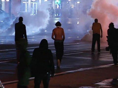 Raw: Police Use Tear Gas in Ferguson Curfew