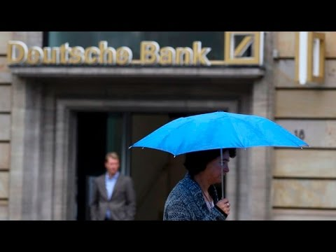 Deutsche Bank shares sink to record low, and other MoneyWatch headlines