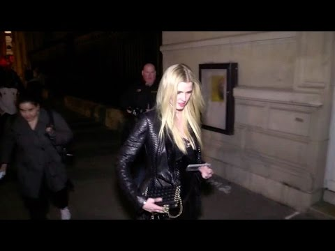 Lara Stone comes out of the 2016 Givenchy fashion  in Paris