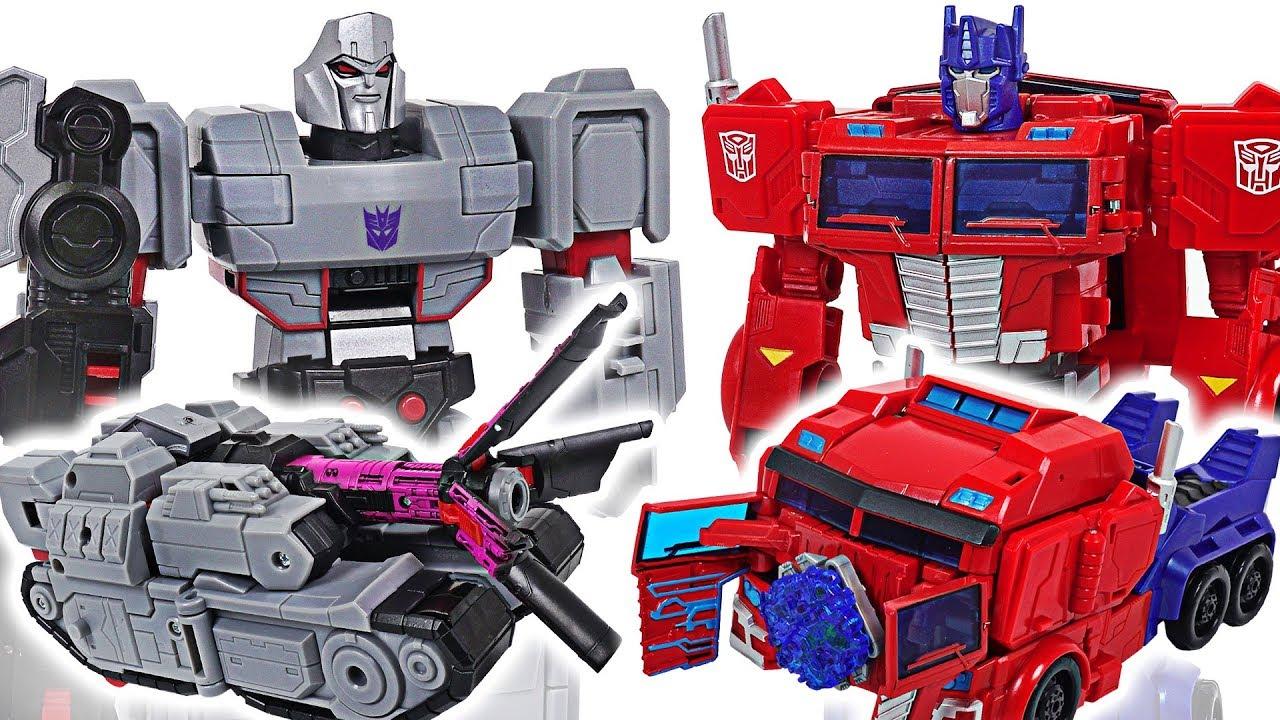 Transformers Cyberverse ultimate class Optimus Prime vs Megatron, dinosuars! - DuDuPopTOY