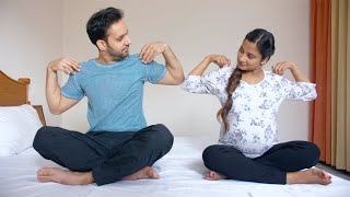Pregnant couple exchanging glances while exercising in bed - pregnancy yoga