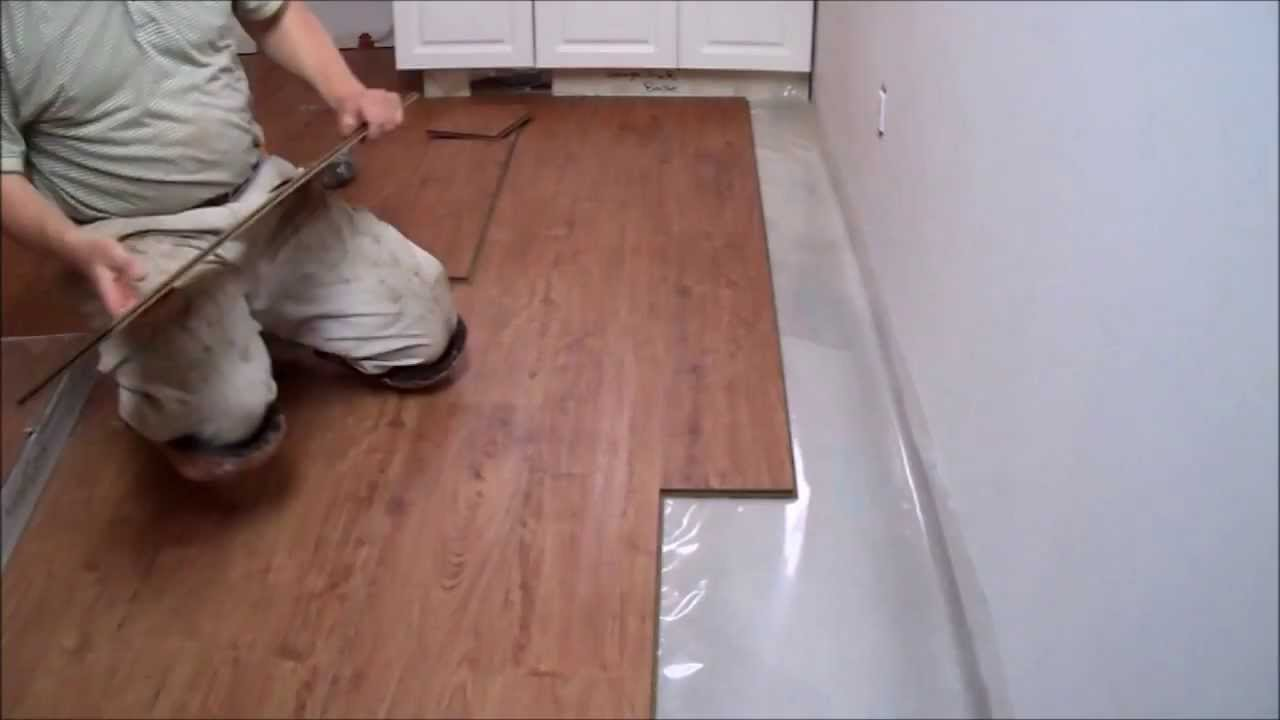 how to install laminate flooring on concrete in the kitchen mryoucandoityourself youtube - Laminate Kitchen Flooring