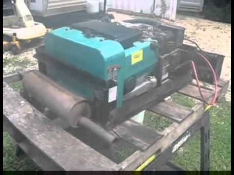 ONAN EMERALD PLUS GENERATOR RUNNING OUTSIDE AN RV MOTORHOME FOR SALE