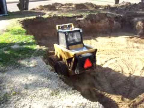 Mustang Skid Steer Digging A Basement You
