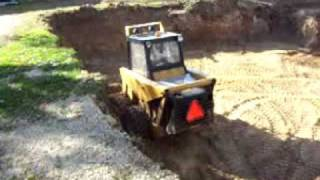 mustang skid steer digging a basement