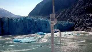 Dawes Glacier shooter and glacier calving in Endicott Arm Fjord Alaska