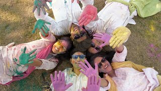 Top view shot of Indian teenagers greeting on the joyful occasion of Holi festival