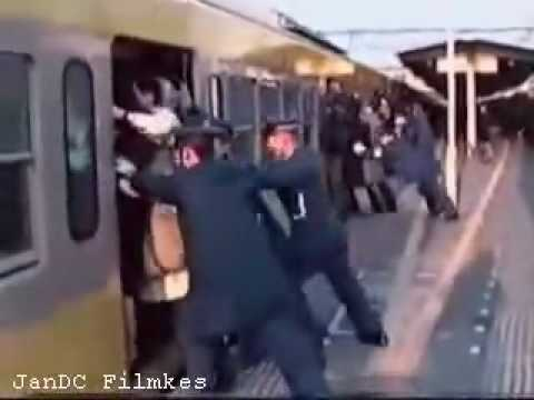 Unbelievable Japan: Passengers forcibly squeezed into train. from YouTube · Duration:  1 minutes 36 seconds